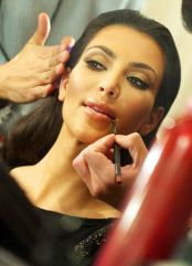Kim Kardashian backstage at The Heart Truths Red Dress Collection 2010. Click here for more attribution information.